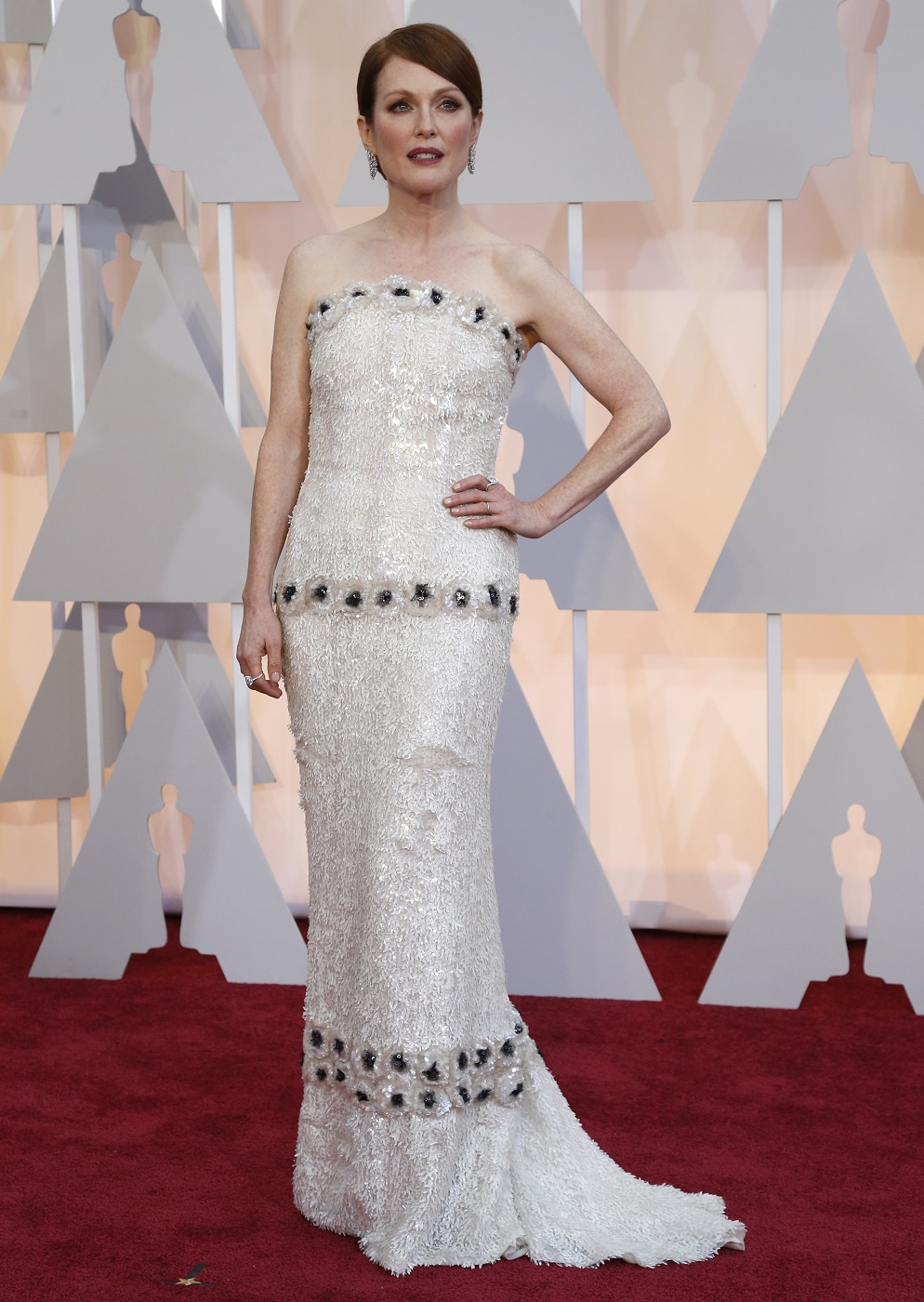 "Julianne Moore, best actress nominee for her role in ""Still Alice,"" arrives at the 87th Academy Awards in Hollywood"