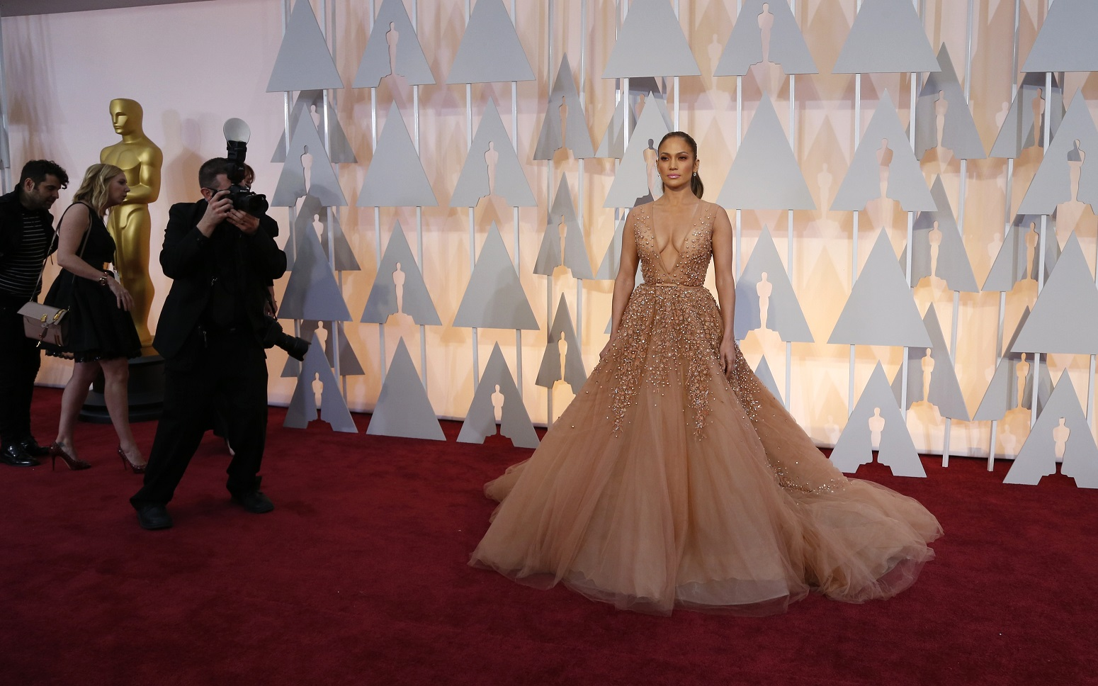 Singer Jennifer Lopez wears a gown by Elie Saab as she arrives at the 87th Academy Awards in Hollywood