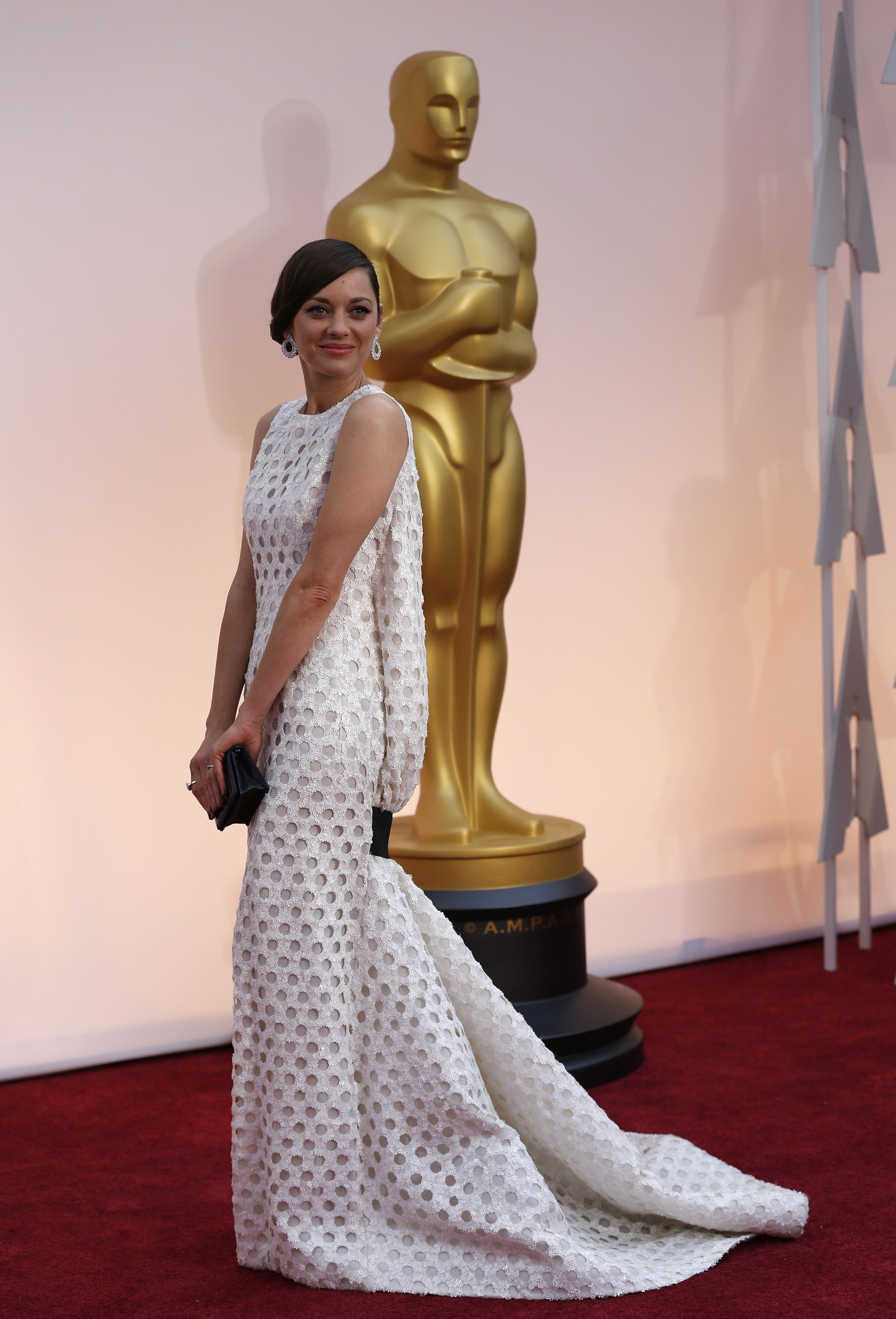 Actress Marion Cotillard wears a Christian Dior gown as she arrives at the 87th Academy Awards in Hollywood